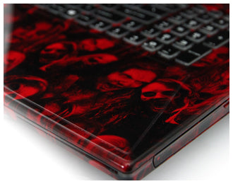 Close up of corner of laptop with zombie hydrodip in red and black.