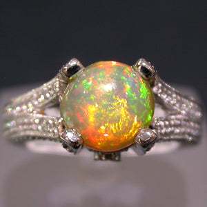 White Gold Ring set with an Ethiopian Opal and Diamonds