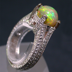 Side view of White Gold Ring set with an Ethiopian Opal and Diamonds