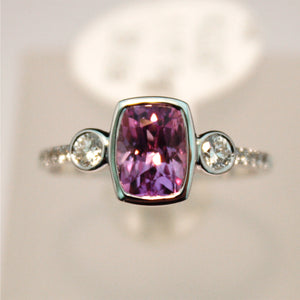 White Gold Ring Set with a Beautiful Pink Sapphire and Diamonds