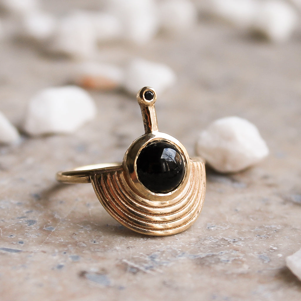 Solid Gold Interstellar Ring Black Onyx with Sapphire