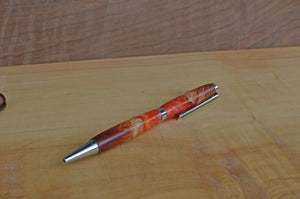 Hand turned pen. Manzanita burl and resin