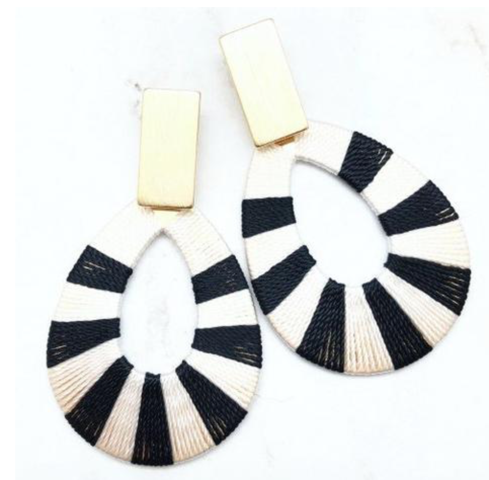 "Fun <a href=""https://huffharrington.com/collections/jewelry/products/shiver-and-duke-black-and-white-hoop-earrings"" target=""_blank"">statement earrings</a> are easy to pack and you don't have to panic if you lose them."