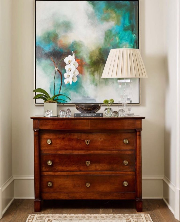 "This makes us so happy: a bright and beautiful abstract by <a href=""https://huffharrington.com/collections/melissa-payne-baker"" target=""_blank"">Melissa Payne Baker</a> over a beautiful antique commode.  Ying and yang, apples and oranges, new and old – we love the mix. Lauren Davenport designed this lovely space."