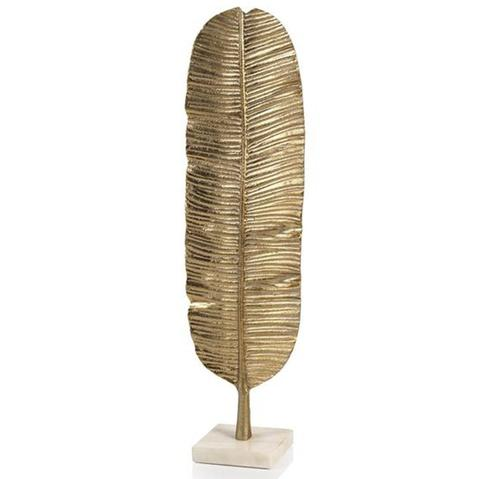 "Sam, who always has exquisite taste, has been coveting this <a href=""https://huffharrington.com/products/banana-leaf-on-marble-stand"" target=""_blank"">banana leaf sculpture</a> as a desk accessory. Her wanting it means we all want it too!"