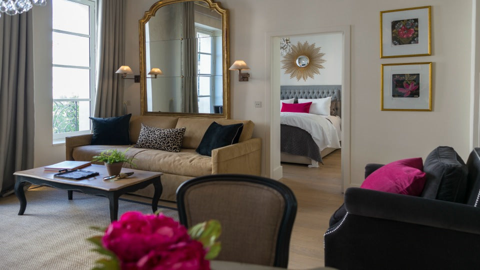 "After:  We let the art dictate the color in the beautiful <a href=""http://www.parisperfect.com/apartments-for-rent-in-paris/muscat.php"" target=""_blank"">Muscat</a> apartment and gave the couch a more tailored and sophisticated look with black pillows."