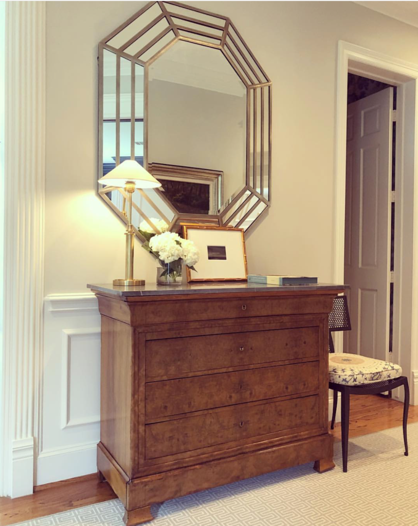 Here Paloma has created a graphic punch, marrying a pretty Louis Philippe walnut chest with an over sized octagonal mirror.