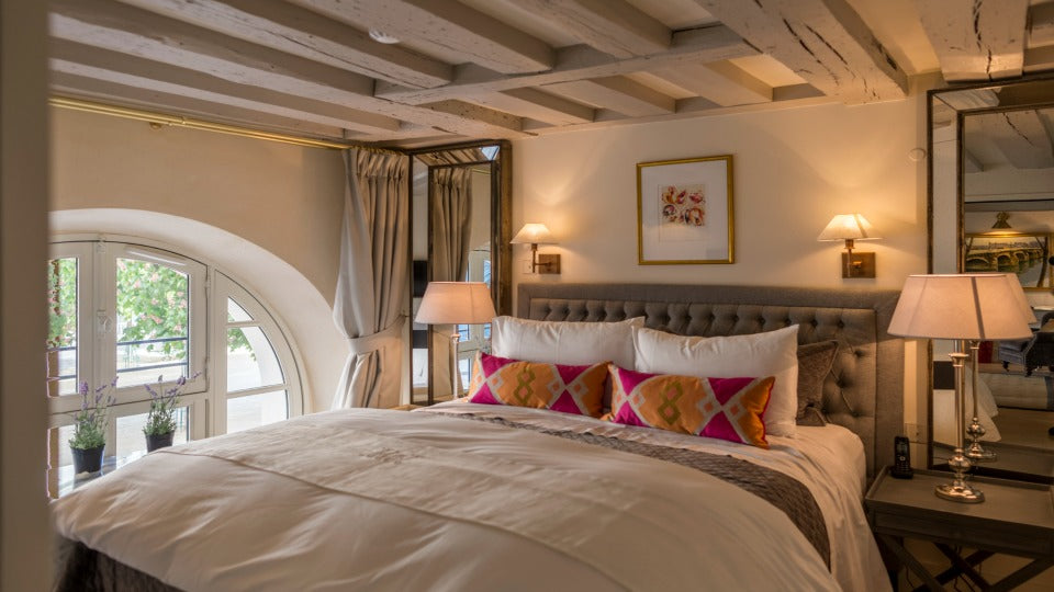"The lively colors in the <a href=""http://www.parisperfect.com/apartments-for-rent-in-paris/ceron.php"" target=""_blank"">Ceron</a> bedroom just brought everything to life – and yes, we hand-carried the pillows across the pond!"