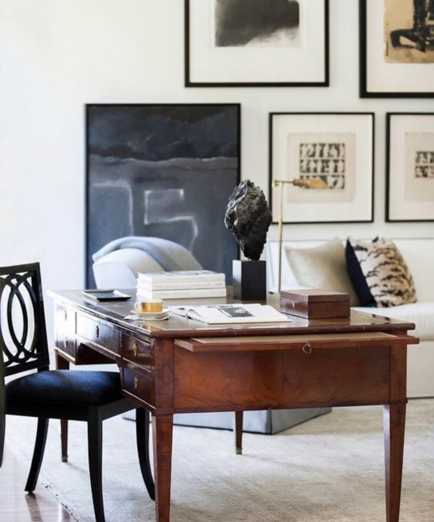 Love this 19th C. French walnut desk paired with a collection of modern art.
