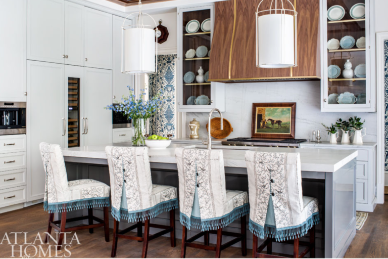 "We don't know if we'll ever stop loving a classic white kitchen, but we're glad color is creeping back into the heart of the home. Especially when it's a dusky blue that gets a lift from some sassily upholstered bar stools. <a href=""https://www.lizgodwininteriors.com/"" target=""_blank"">Elizabeth Godwin Interiors</a> & Kingdom Woodworks"