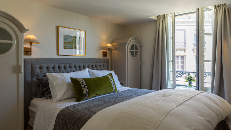 "Our favorite cozy bedroom: <a href=""http://www.parisperfect.com/apartments-for-rent-in-paris/monbazillac.php"" target=""_blank"">Monbazillac's</a> beautiful linens, custom pillows, taking their cue from the artwork, and the piece de resistance:"