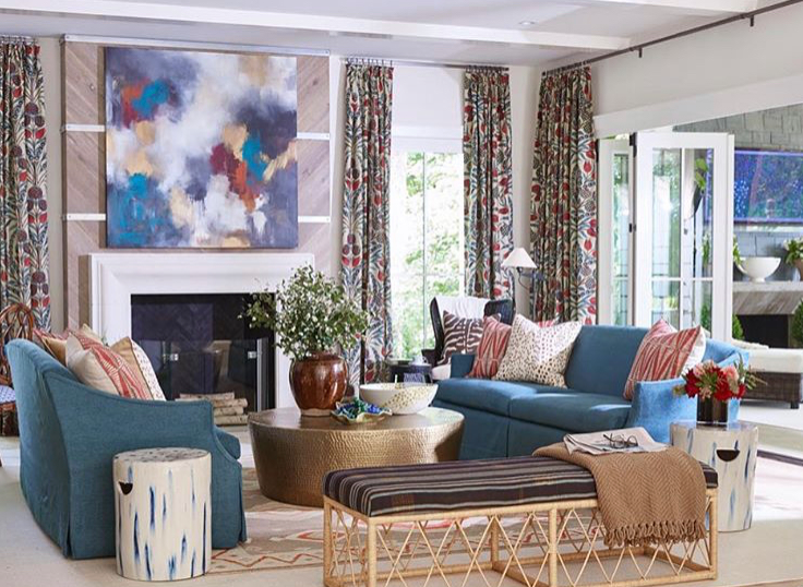 The finished family room with its shades of blue, raspberry and gold.  We were thrilled with the way the painting looks over the fireplace.  (photo: Victoria Pearson)