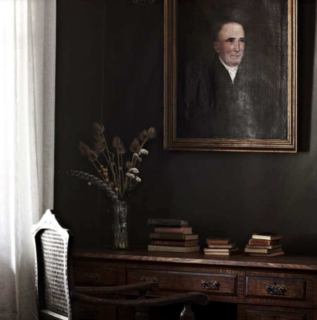 "This kindly gentleman looks great with this dark and dramatic interior. (<a href=""https://estliving.com/ellis-house/"" target=""_blank"">Est Magazine</a>: photography by Sharyn Cairns.)"