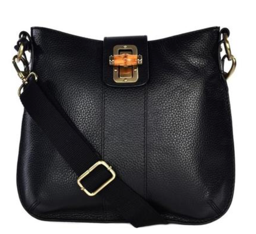 "Our fave <a href=""https://huffharrington.com/collections/for-her/products/loxwood-celia-bag-with-bamboo-lock-in-black"" target=""_blank"">cross-body bag </a> from Loxwood. We love the bamboo detailing and the wide guitar strap handle."