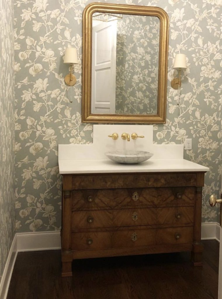 We love what she's done here with this French regency burled walnut commode, and added a fresh white slab of marble to it. So clean and so pretty!