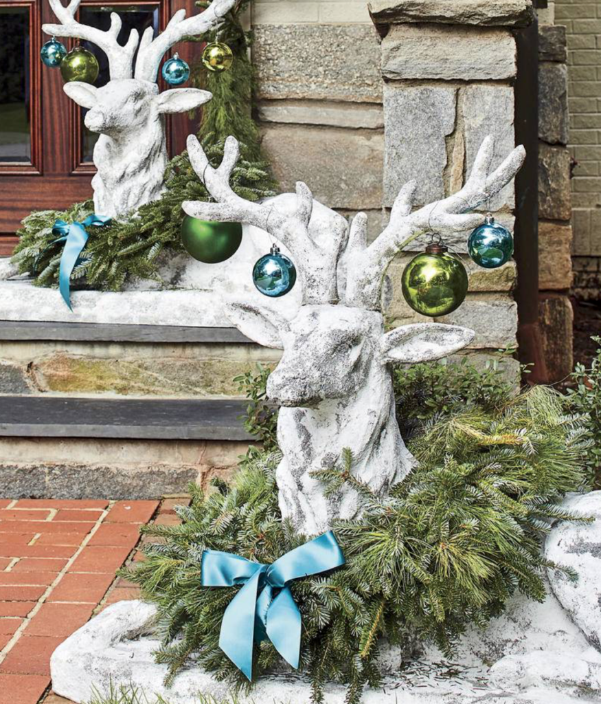 "Have some fun. Even your stone friends can get dressed up for the holidays. (<a href=""https://www.southernliving.com/christmas/decor/fresh-christmas-greenery?slide=561044#561044"" target=""_blank"">Southern Living</a>/Laurey W. Glenn)"