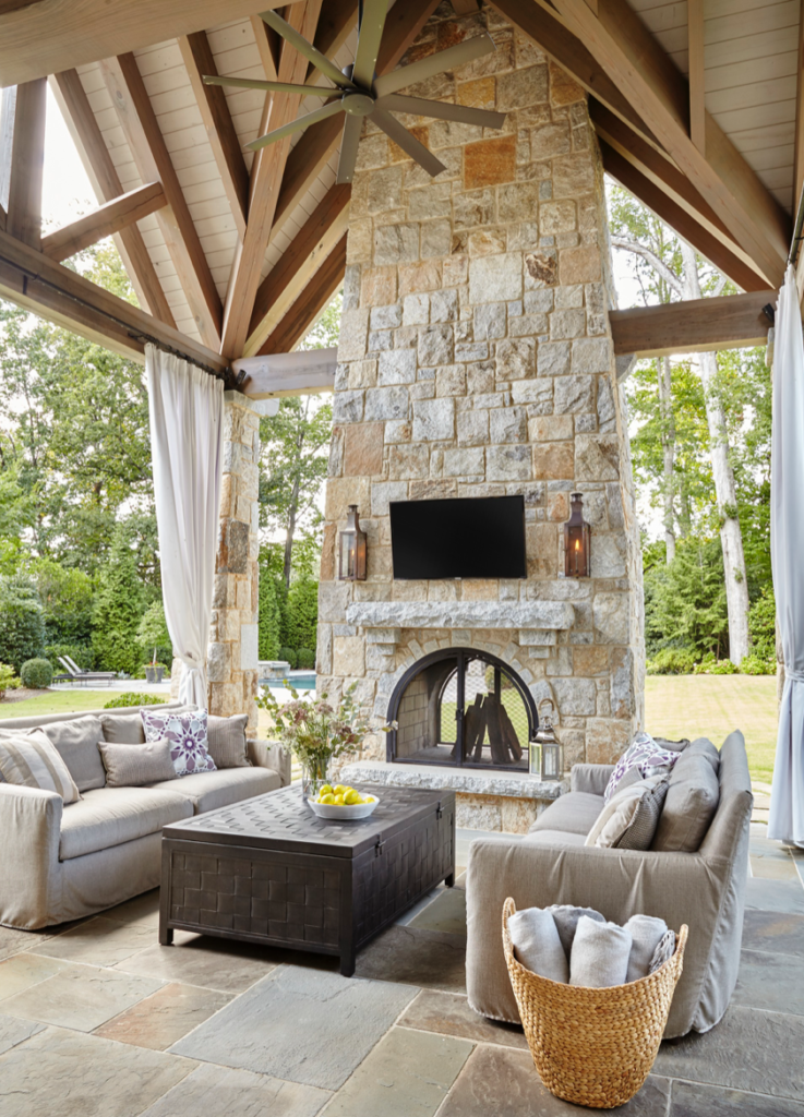"A soaring ceiling, a gorgeous fireplace and beautiful, comfortable furnishings make this the place to be for outdoor time. (<a href=""http://www.traditionalhome.com/"" target=""_blank"">Traditional Home</a>/Emily Followill)"