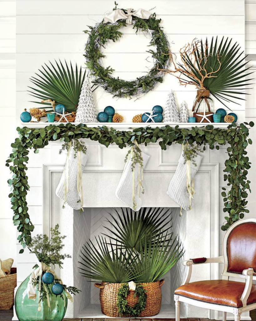"Headed to the beach? Keep the seaside vibe going with palms mixed with your greenery. (<a href=""https://www.southernliving.com/christmas/decor/fresh-christmas-greenery?slide=561044#561044"" target=""_blank"">Southern Living</a>/Laurey Glenn)"
