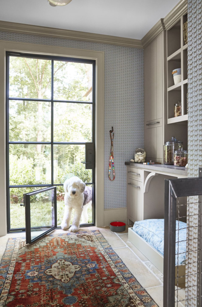 Even the pooches have a spot to call their own. This is the dog mudroom, complete with a fancy iron dog door, a shower, and a comfy bed.  (Photo: Victoria Pearson)