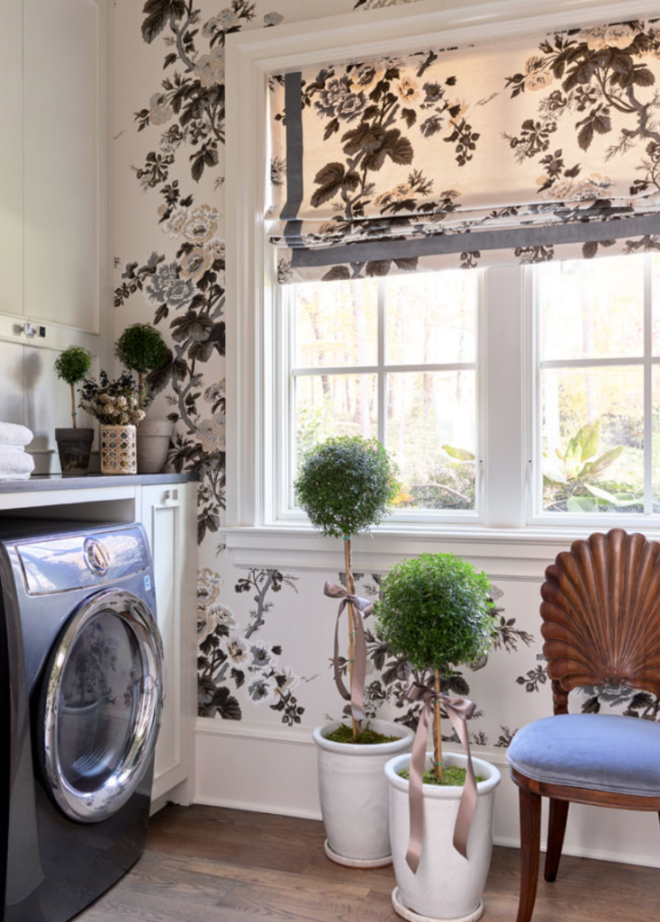 "<a href=""https://www.laurenelaineinteriors.com/"" target=""_blank"">Lauren Elaine Interiors</a> used Pyne Hollyhock wallpaper to make a statement in the cheerful and absolutely adorable (and Instagrammable!) laundry room."