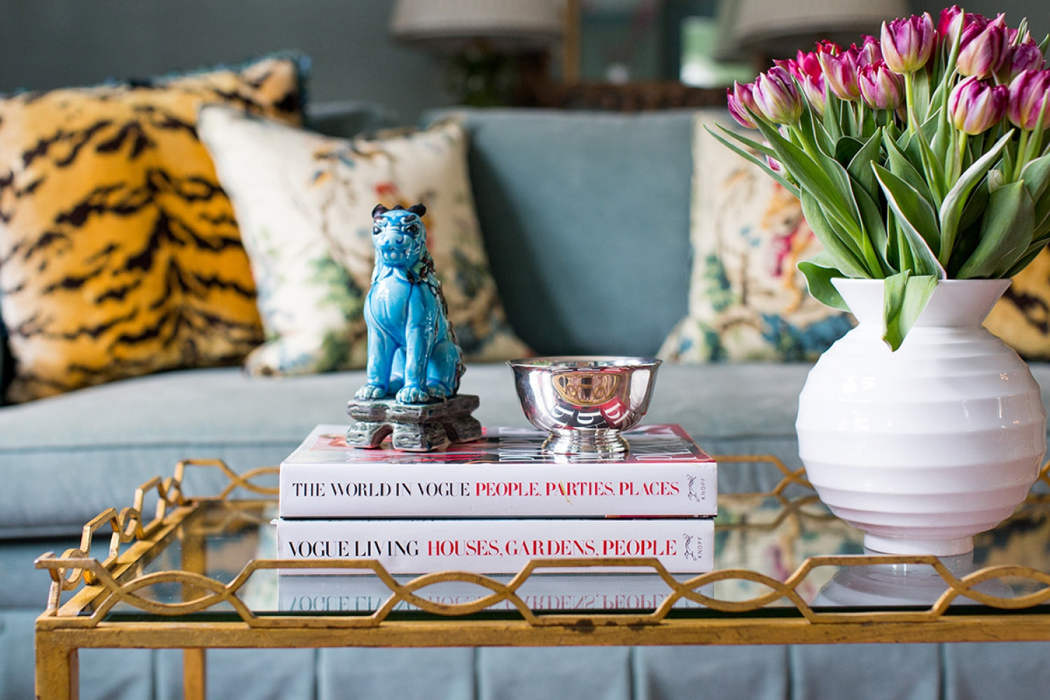 "<a href=""https://mallorymathison.com/"" target=""_blank"">Mallory Mathison</a> knows her book covers and picked the perfect pairings for this pretty coffee table vignette (image from her website)"