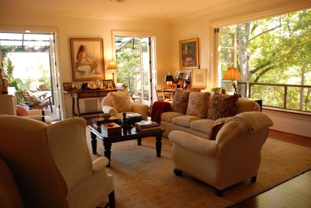 The formal living room with its French molding and beautiful windows framing the Buckhead treetops