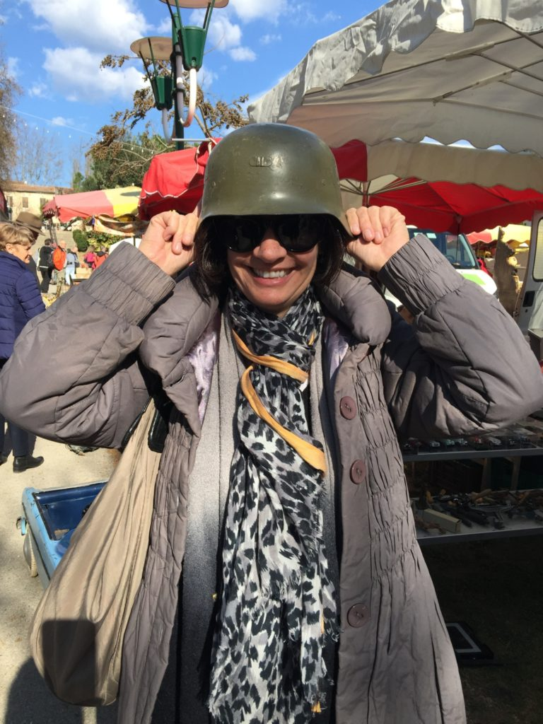 Meg, our WWII buff and expert, had to try on one of the helmets at the fair!