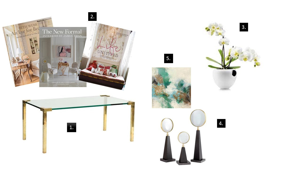 "Elements of a copy table: 1. start with a sleek 1970s brass and glass <a href=""https://huffharrington.com/collections/furniture/products/peter-ghyczy-brass-and-glass-signed-coffee-table"" target=""_blank"">coffee table</a>. 2. Add your foundation with <a href=""https://huffharrington.com/collections/books"" target=""_blank"">coffee table books</a>. 3. Go for the green with a pretty floral or orchid arrangement. 4. Add some height with a set of three chunky and cool <a target=""_blank"" href=""https://huffharrington.com/collections/decor/products/introspection-sculptures"">magnifiers.</a> 5. Add the personal touch with a little painting (this one by <a href=""https://huffharrington.com/collections/melissa-payne-baker/products/melissa-payne-baker-emerald-joy"" target=""_blank"">Melissa Payne Baker</a>"