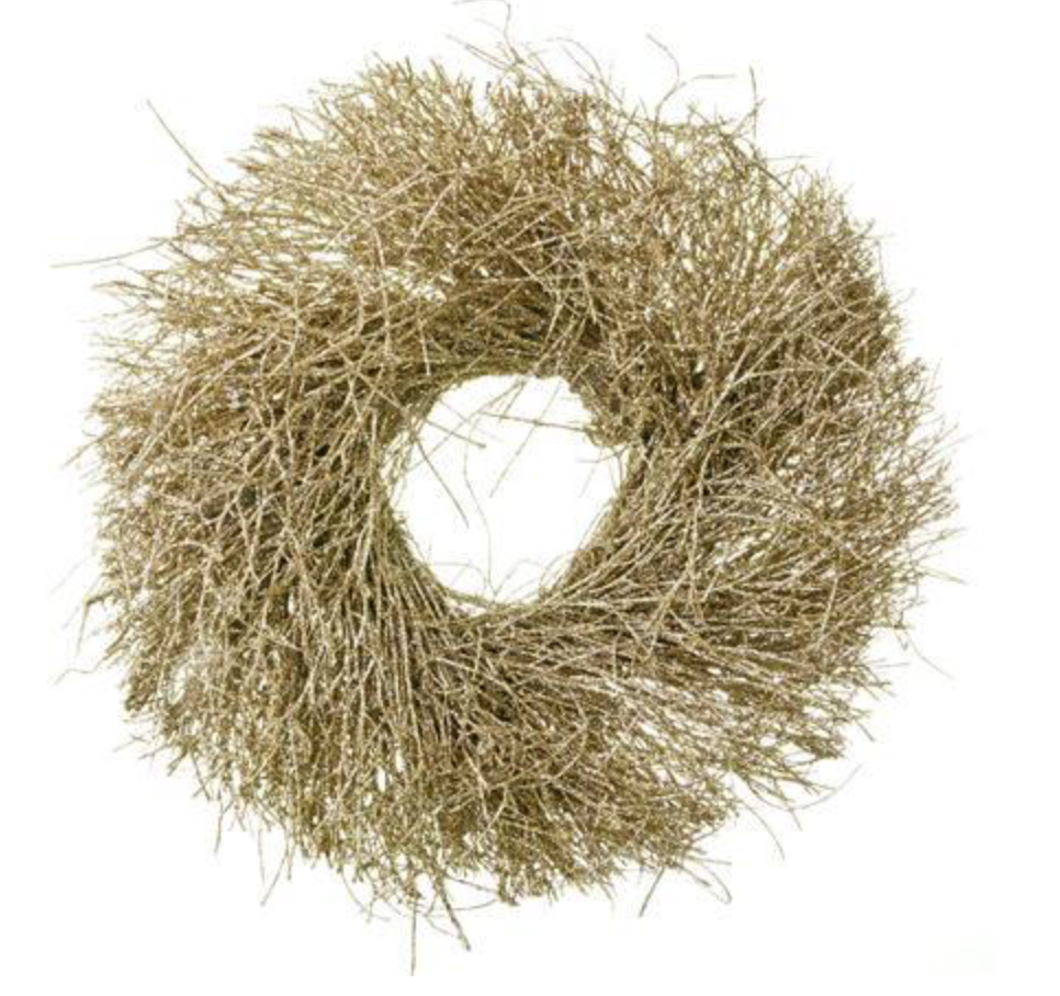 "We love <a href=""https://huffharrington.com/collections/decor/products/glitter-wreaths-1?variant=4904116912158"" target=""_blank"">glitter wreaths</a> – especially when they're hung over a Louis mirror."