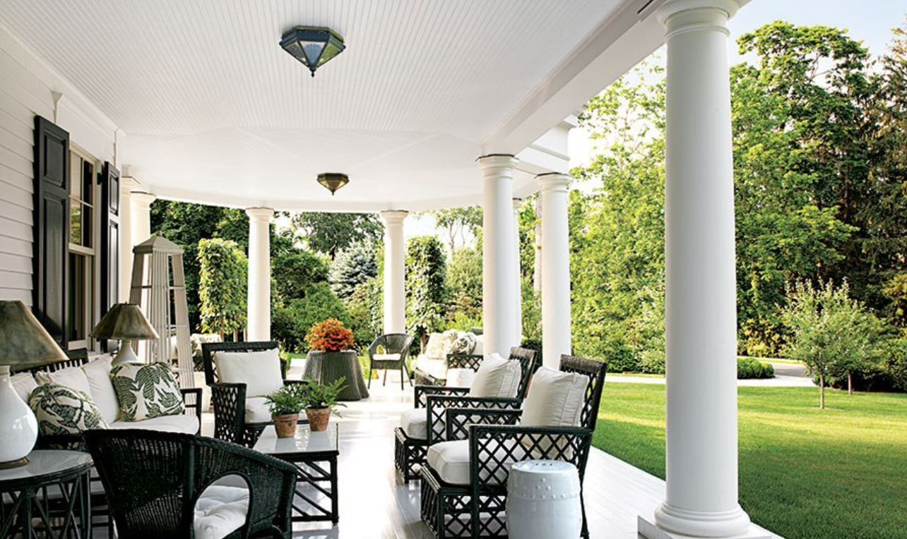 "Miles Redd did this gorgeous and inviting porch. <a href=""https://www.architecturaldigest.com/"" target=""_blank"">Architectural Digest</a>, photography by Miguel Flores-Vianna."