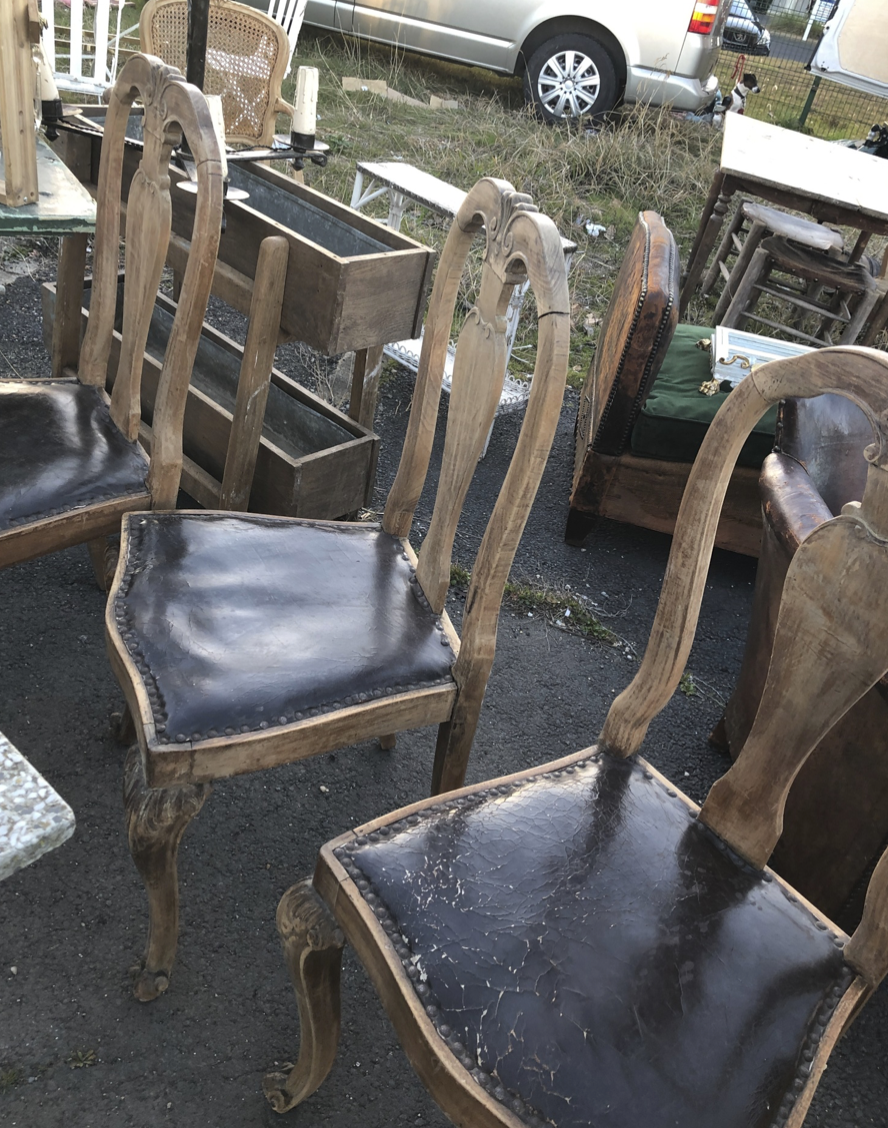 Stripped oak Queen Anne style old and crackly leather chairs. We have six.