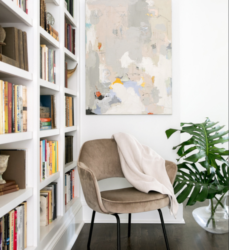 "A Danish mid-century chair from France looks perfect with an abstract from <a href=""https://huffharrington.com/collections/andrea-costa"" target=""_blank"">Andrea Costa</a>."