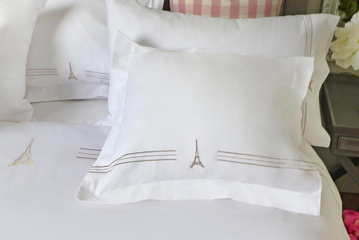 "Everyone is raving about our <a href=""https://huffharrington.com/products/european-square-sham-pillow-cover"" target=""_blank"">new sheets from Paris</a>. There's too much to say about them here, but what a great gift! If you can't spring for a whole set, she'll be thrilled with a pair of shams."