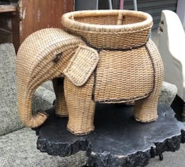 A perfectly sophisticated little wicker elephant side table.