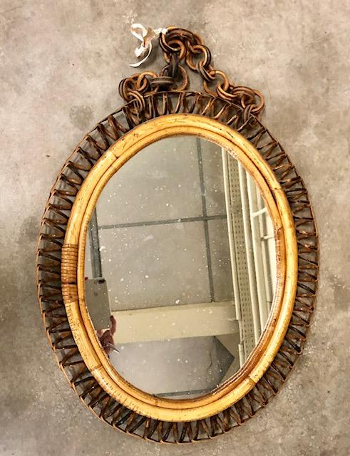 We fell for the age and patina on this mirror, along with its pretty necklace!