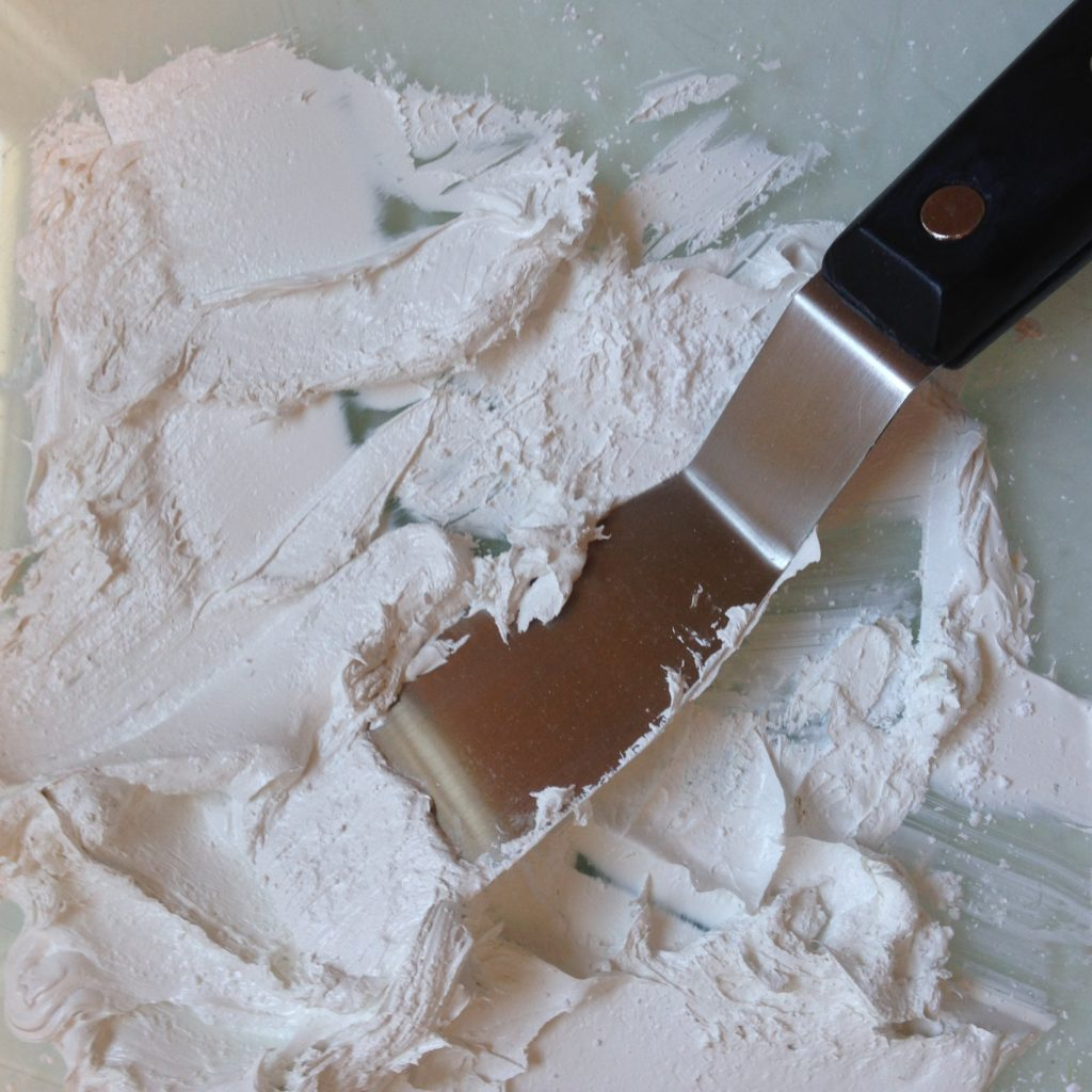 The artist's favorite painting weapon, the palette knife, and the texture that is reminiscent to textile design