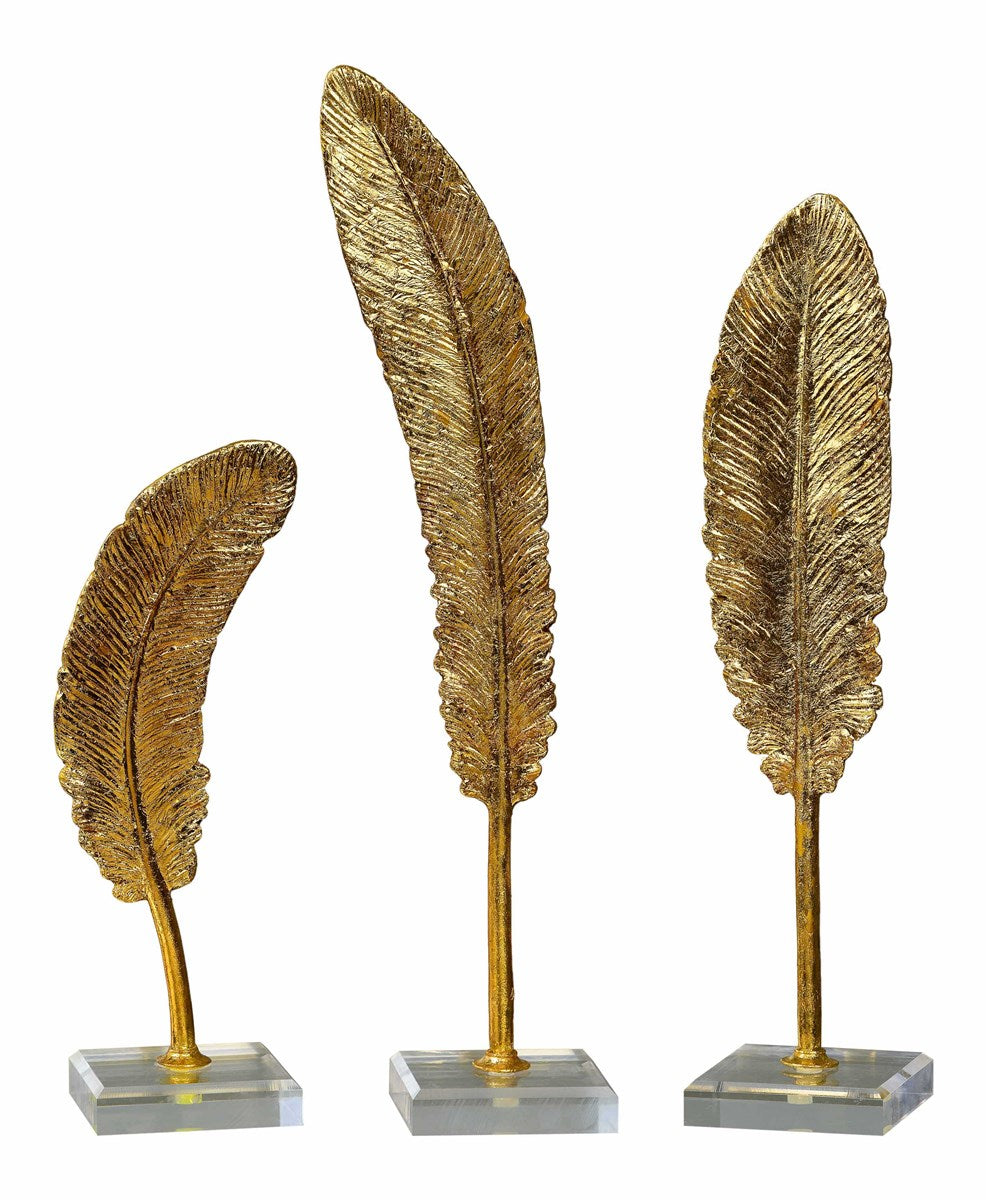 Gold Feather on Lucite Block