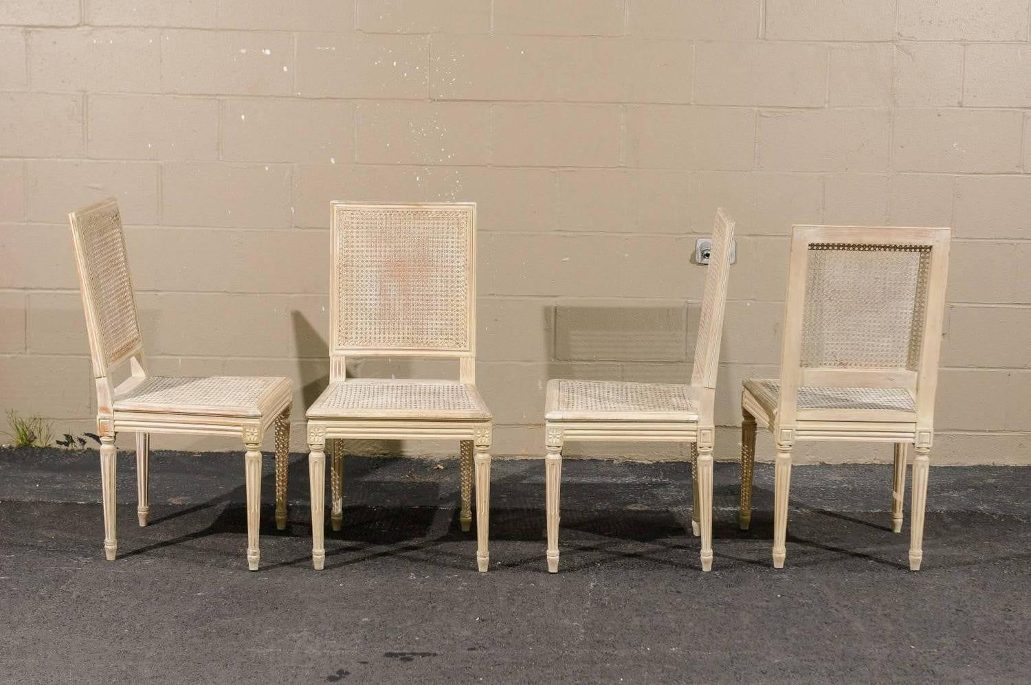 Four French Louis XVI Style Painted Wood and Cane Dining Chairs ...