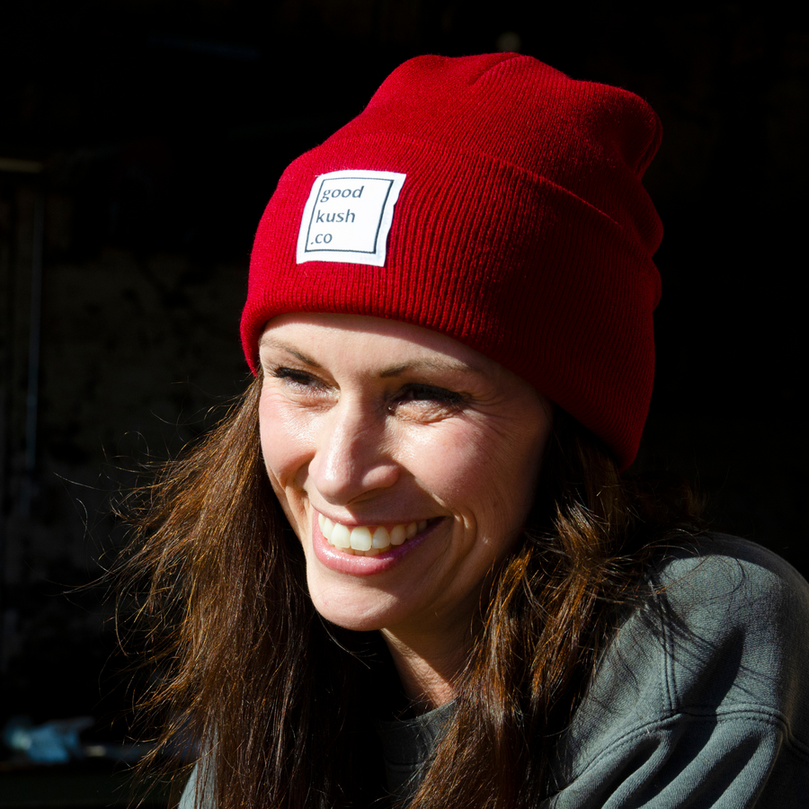 Wowan with large smile wearing a Panama Red Lil' Blunt Beanie by the good kush company.