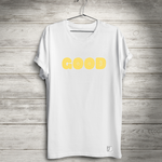 A white t-shirt is hanging from a wire hanger. The work GOOD is across the chest. A small tag saying good kush dot co is sewn on the bottom left hem.