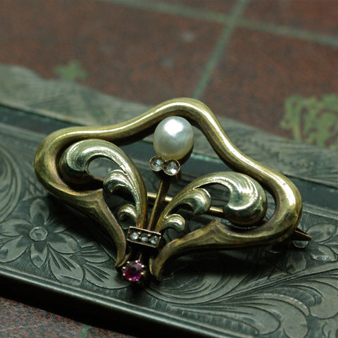 Circa 1900 Art Nouveau 14k, natural pearl, diamond and ruby brooch