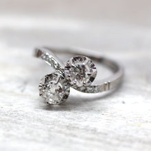 Circa 1920's 18K white gold & diamond bypass ring