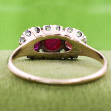Three Stone Ruby Ring with Rose Cut Diamond Halo c1900