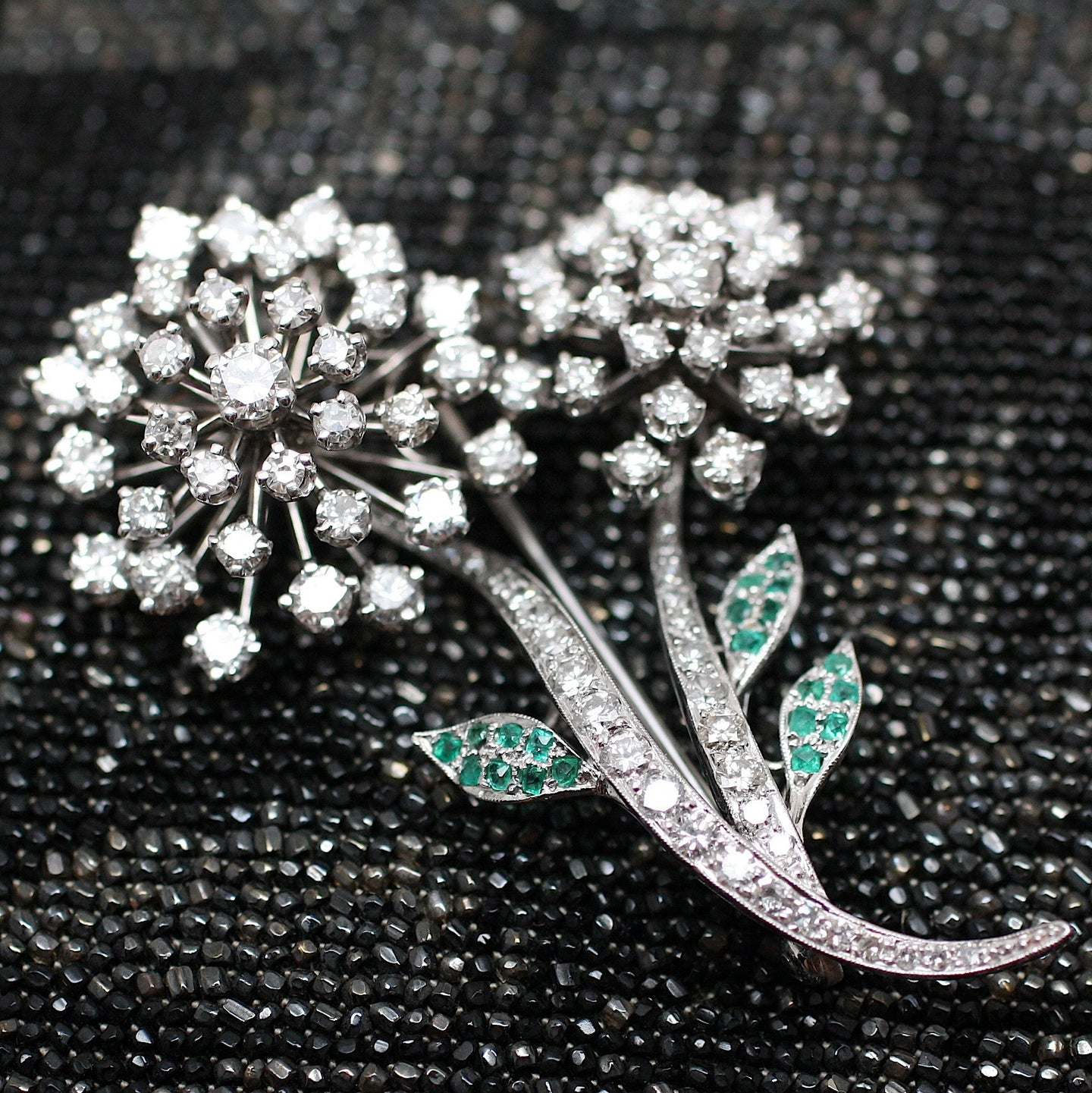 Circa 1950 Platinum, Diamond, Emerald Flower Pin