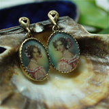 Circa 1930s 14k portrait earrings with hand painted details