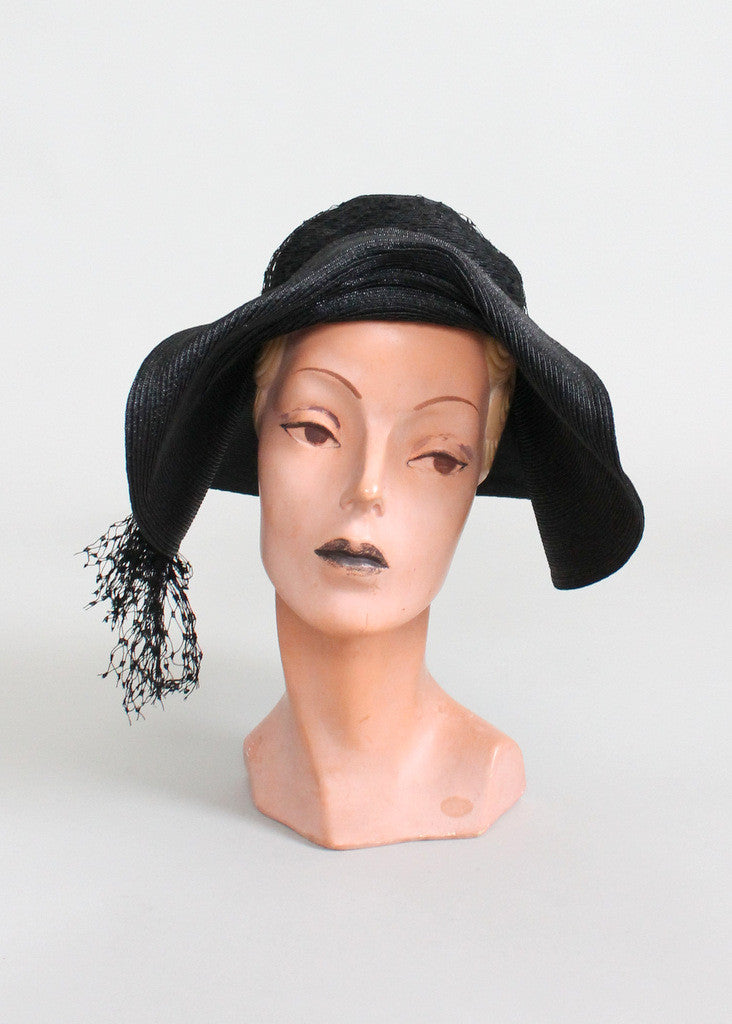 3416f98c FREE shipping on US orders over $200 (some exceptions apply). Home >  Products > Vintage Early 1930s Black Straw Floppy Hat