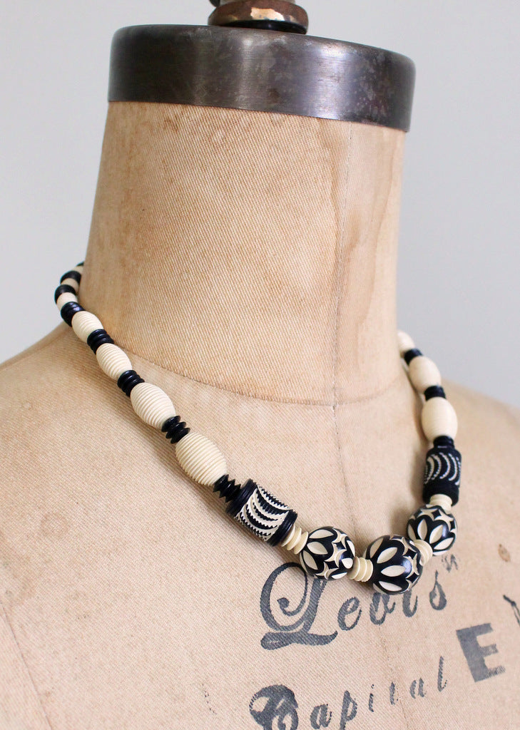 1930s carved celluloid necklace