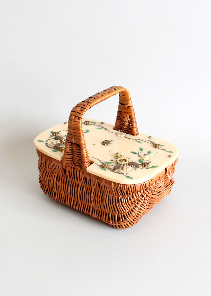Vintage 1940s wicker and celluloid handbag