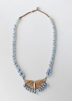 Vintage 1930s Blue Beaded Necklace with Brass Butterfly