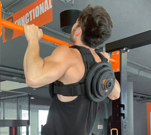 weighted pullups being performed using a weighted vest